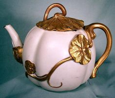 Beautiful Antique Royal Worchester teapot pot entwined by a gilded lily pad, ca.1880.