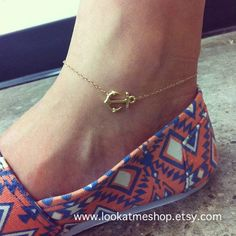 Hey, I found this really awesome Etsy listing at http://www.etsy.com/listing/127646520/sideways-anchor-anklet-14k-gold-filled