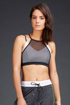 57e271897d This layered bralette can be worn to the gym or to the club. This sports
