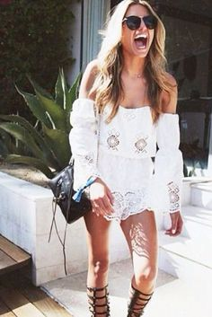 Summer style inspiration. White off the shoulder boho romper. Black fringe purse and gladiator sandals. On trend.