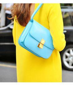 Robin's Egg Blue Celine Bag against fluorescent yellow dress. Gorge.