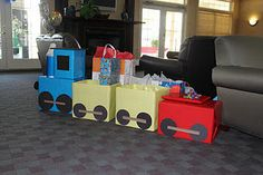 Train made out of diaper boxes, wrapping paper and construction paper.  Kept the boxes open, to hold the presents :)