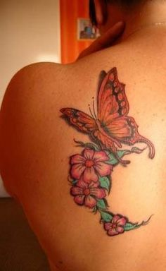 Elegant Butterfly with Flowers Tattoo