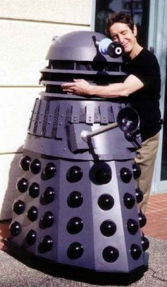 Paul McGann hugs a Dalek. I am in love with this picture.