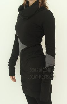 This tunic dress has a cowl neckline and extra long scrunch-able sleeves. Black with cement grey geometric color block details. Cotton spandex jersey. Triple banded hem. Super soft and comfortable design. Handmade to order. Please check the shop announcement for my current turnaround time- http://www.etsy.com/shop/joclothing?ref=si_shop Available in sizes X-Small, Small, Medium, Large, X-Large, XX-Large. (please indicate the size you would like or provide your measurements in the notes to…