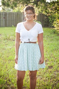 Repurpose your favorite white tee by wearing it over a dress, knotting it and adding a belt.