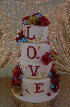 Red and gold with hints of blue wedding cake
