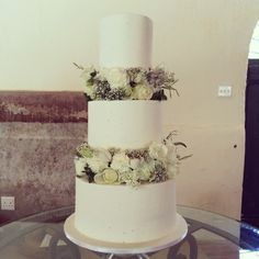 Three tier frosted cake with fresh flower tiers by The Birdcage, Stellenbosch