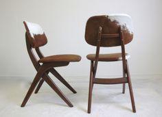 Louis Van Teeffelen's chairs revisited by Project99 Amsterdam for CHROMATICS Paris http://www.chromatics.fr/fr/chaisesassises/211-chaise-bois-peau-vache.html