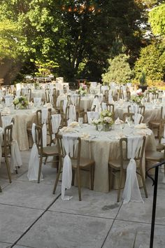 This reception has a beautiful neutral color palette with champagne linens and ivory chair sashes. Wedding Venue: Ceresville Mansion in Frederick, Maryland Photographer: Shaun Campbell at Creative Force Photography