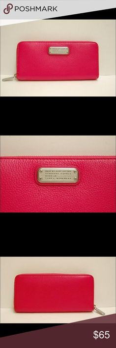 "MARC BY MARC JACOBS SINGING ROSE wallet MARC BY MARC JACOBS SINGING ROSE WORKWEAR Q SLIM ZIP CLUTCH WALLET 100% Leather Marc by Marc Jacobs slim zip around wallet, pink, singing rose, which is dark pink Size:7.75 "" L x 3.75 in "" H x 1 Deep. Includes: 8 cards holder , a zip coin Spot, & 2 bill pockets Marc Jacobs Bags Wallets"