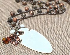 Boho crochet necklace, long beaded crochet necklace - gemstones - shades of rust/gray/topaz, dramatic etched bone pendant, crochet  jewelry