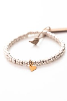 Sterling Silver Mini Link Charm Bracelet. Made with a optional dangling heart charm. A perfect gift | Talulah Lee