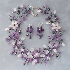 This captivating purple amethyst jewelry set will compliment any attire with grace and charm. Boasting a display of rich purple amethyst, icy quartz, and freshwater black pearls, this handcrafted necklace and earring set makes for great formal wear.