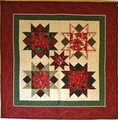 Poinsettia Stars, made July 2010. This Christmas wallhanging was made to showcase poinsettia fabric from a fat quarter bundle.