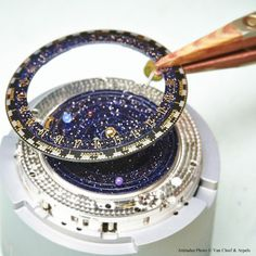 Van Cleef & Arpels Midnight Planétarium Poetic Complication timepiece, Poetic Complications™ collection #PoeticAstronomy #SIHH2014 Graduated calendar assembling.