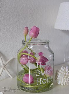 Creative flower arranging: nested pink tulips in a clear glass vase. Find out how at http://www.songbirdblog.com