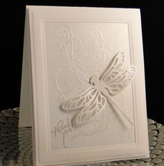 Thank you 2017 (J&N) SU Flourish wet embossed with silver pearl EP on pearl white paper, framed with Spellbinder dies. SU dragonfly backed with vellum covered with Star Dust Stickles on top of vellum. A4 size Created by Peggy Dollar