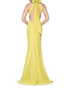 """<ul><li>Enchanting open-back flared dress with a cute bow accent</li><li>Halterneck</li><li>Sleeveless</li><li>Lightly padded</li><li>Full coverage</li><li>Open-back with tie-up</li><li>Back zip closure</li><li>Flared silhouette</li><li>Polyester lining</li><li>About 63"""" from shoulder to hem</li><li>Polyester..."""