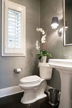 Gorgeous grey powder room! www.choosechi.com