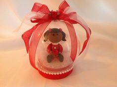 Little girl in a globe, dressed in red and white. $15