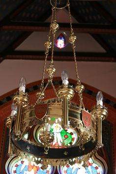 The restored and refitted chandelier that illuminates the private chapel.