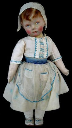 Francia doll. France. Child holding Breton origin. Most of the dolls are Francia considered a classic outfit, outside a doll holding Dutch child, a doll dressed in Alsace and this baby dressed in Breton. 50 cm. Circa 1916. Private Collection. EU  http://french-cloth-dolls-encyclopedia.com/web/index.php/fr/historique?id=67
