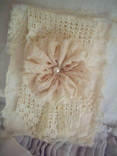 Beautiful card made from antique laces, vintage silk rosette, and pearl