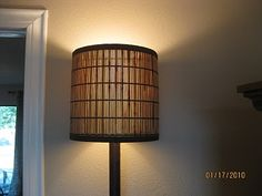 This was a crappy looking Wal-Mart lamp (you know which ones I'm talking about - the torcherie lamps)...bamboo table runner for $6.00 transforms it!