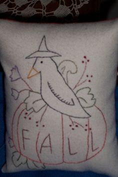 crow on fall pumpkin stitchery pillow
