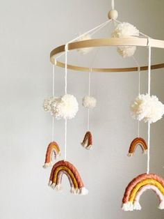 "The sweetest mobile for any nursery or kids room! With rose and gold tones, this pom pom mobile makes for a beautiful addition to any space! Approx dimensions: 15-16"" h x 12-13"" w ****Colors are easily customizable so feel free to reach out if you are looking for specific colors or sizing.****"