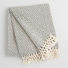Crafted of woven cotton with a subtle chevron pattern and handsome knotted fringe, our charcoal gray and ivory throw brings natural warmth and style to any sitting space.