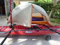 Captain Chaos added a pair of repositionable side decks (hakas) to his Hobie Adventure Island.  When they're both mounted on the same side he can set up a small side entry backpacking tent.  This is a Big Agnes Copper Spur UL 1.