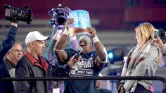 Butler leads Nevada to Arizona Nevada running back James Butler holds the Arizona Bowl trophy after the Wolf Pack beat Colorado State on Tuesday.   12/29/2015