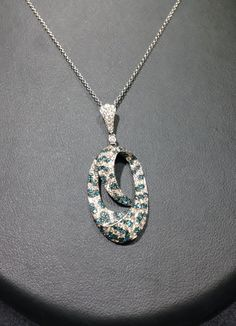 New at FMJ!! Beautiful 14k white gold blue and white diamond necklace. #ChicagoJewelry #Diamonds #WinterFashion