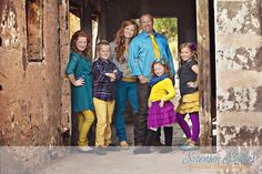 Don't be afraid of color!  I love how this family pulled together their clothing in a unique way.  Great outfits can really help make a picture special.  125+ Family and Sibling Photos to Get Posing Ideas and Inspiration.  #photography #outfits #harvardhomemaker #family
