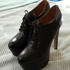 Platform heels Black lace up, platform heels never worn outside they're just collecting dust Shoe Dazzle Shoes Heels