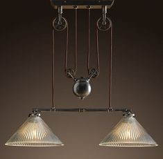 This industrial pulley double pendant would be awesome over a poker table or dining table.
