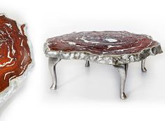 craig+narramore old growth wood slab table infused with metal, cast aluminum legs.