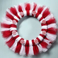 This kid-friendly Christmas craft is sweet as can be. Have the kids help create this candy-inspired wreath. All it takes is a simple tying technique and some glue. /