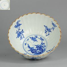 Ca 1700 Kangxi Chinese Antique Porcelain Bowl Flower & Bird Yu Marked   Extremely nice and Rare piece from the Kangxi Period. Thinly potted and moulded in a chrysanthemum shape, the clear white body painted in vibrant washes of underglaze cobalt with shaped panels of insects and flowers, the interior with a further circular medaillon to the centre and floral sprays to the well. The rims with brown slip, the bases marked Yu