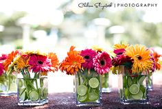 Very cool!  Love the lime slices, they add a ton of interest and conceal the very plain stems of the gorgeous gerberas! brendasweddingblog.com