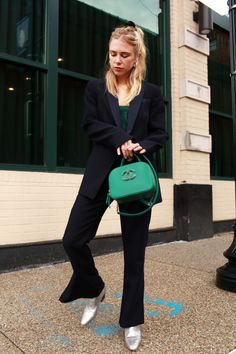 Camilla and Marc suit with green Chanel bag