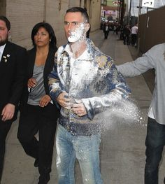 "Set to perform with his band, Maroon Adam Levine got sugar-bombed by a fan on the way into Jimmy Kimmel Live yesterday. The alleged sugar-thrower also supposedly tossed a rock at Dwayne ""T… Adam Levine, Celebrity Gossip, Celebrity News, Funny News Stories, Just Lyrics, Maroon 5 Lyrics, Jimmy Kimmel Live, Just For Laughs, In Hollywood"