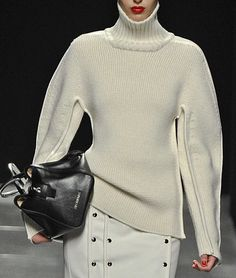Winter white outfit with subtle metallic accents, oversized sleeves and collar.