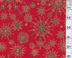 PATCHWORK FABRIC FAT QUARTER  METALLIC GOLD SNOWFLAKES/CRYSTALS ON A RED BCKGRND