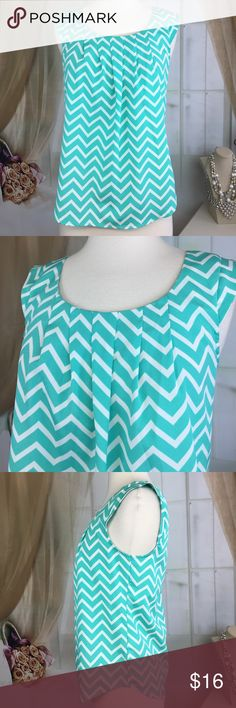 "Candie's Sea-foam Green Chevron Sleeveless Blouse Super cute seafoam green Chevron print sleeveless blouse. 100% polyester. New condition. Size S. Bust measures flat armpit to armpit 17"" and length 22"". PT 506 LOC-6 Candie's Tops Blouses"