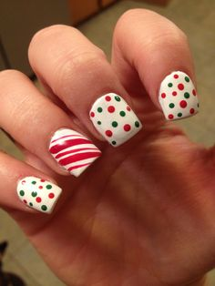 Christmas Nails- white base with red and green dots and a candy cane stripe accent