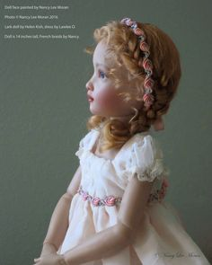 """Doll face painted by Nancy Lee Moran, photo © Nancy Lee Moran 2016 ♡ """"Graceful Kish Doll in Profile"""" is a print on Fine Art America, at link:  http://fineartamerica.com/featured/graceful-kish-doll-in-profile-nancy-lee-moran.html ♡ The print has no words on it.  Lark vinyl doll by Helen Kish is 14 inches tall, dress by Lawlee O'Connor, French braids by Nancy Lee. #Kish #doll #NancyLeeMoran"""