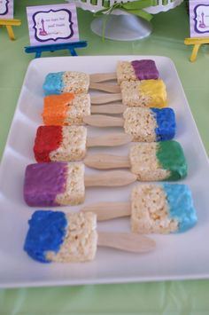 Rice krispy treats Paint brushes for Elise's art themed birthday party this summer.  First make rice crispy treats with rice krispies and marshmallows, when cool insert popsicle stick. To make paint, melt white chocolate and add food coloring!! Dip in rice krispie paint brush an there you go!! =^^=